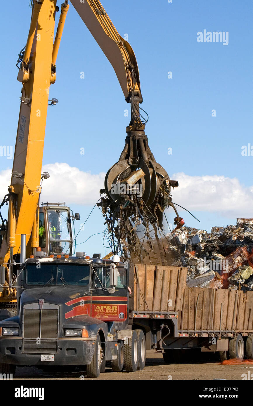Hydraulic grapple lifting scrap steel for recycling at the Pacific Steel and Recycling center in Elmore County Idaho - Stock Image