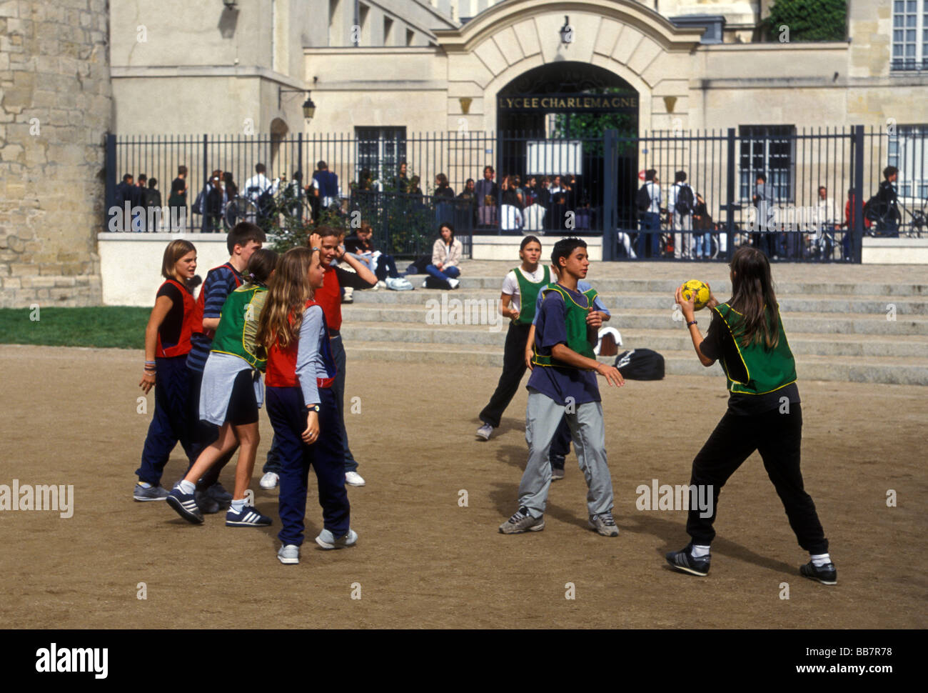 French boys, boys, and, French girls, girls, French students, teens, teenagers, playing ballgame, Lycee Charlemagne, - Stock Image