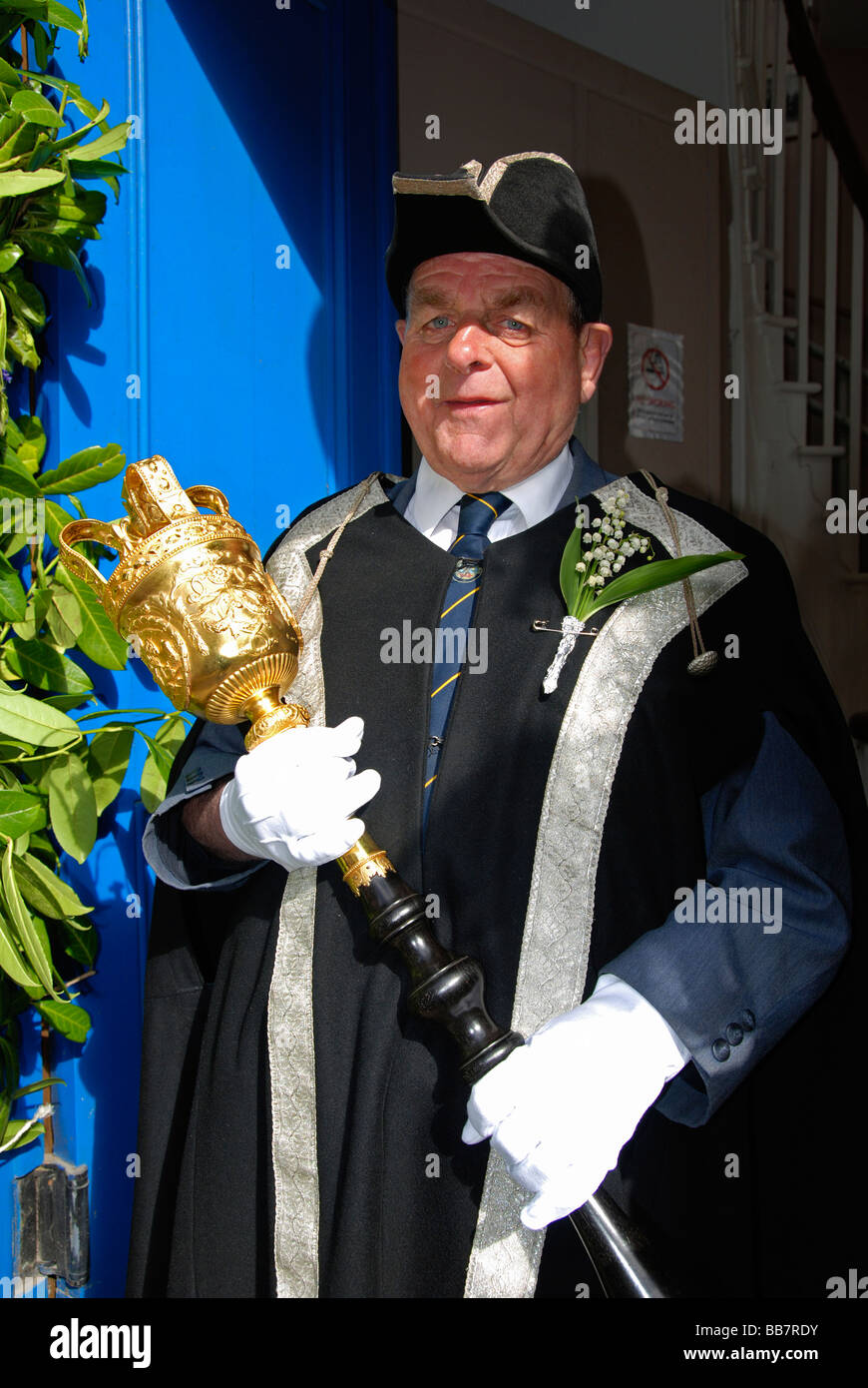 a town hall official on 'flora day' in helston,cornwall,uk - Stock Image