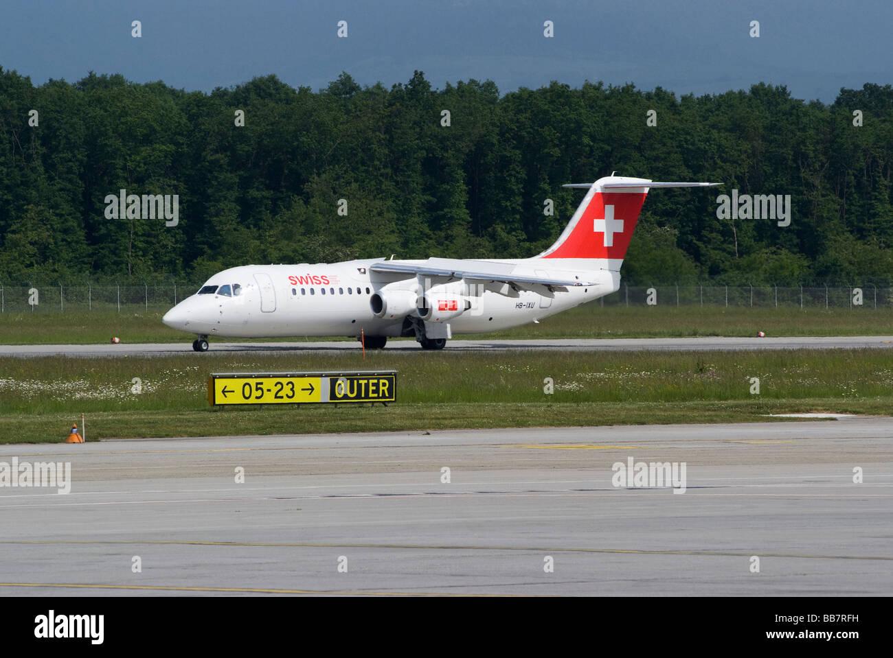 Swiss European Air Lines Avro RJ100 (BAe Avro146-RJ100) HB-IXU Landing at Geneva Airport Switzerland Geneve Suisse - Stock Image