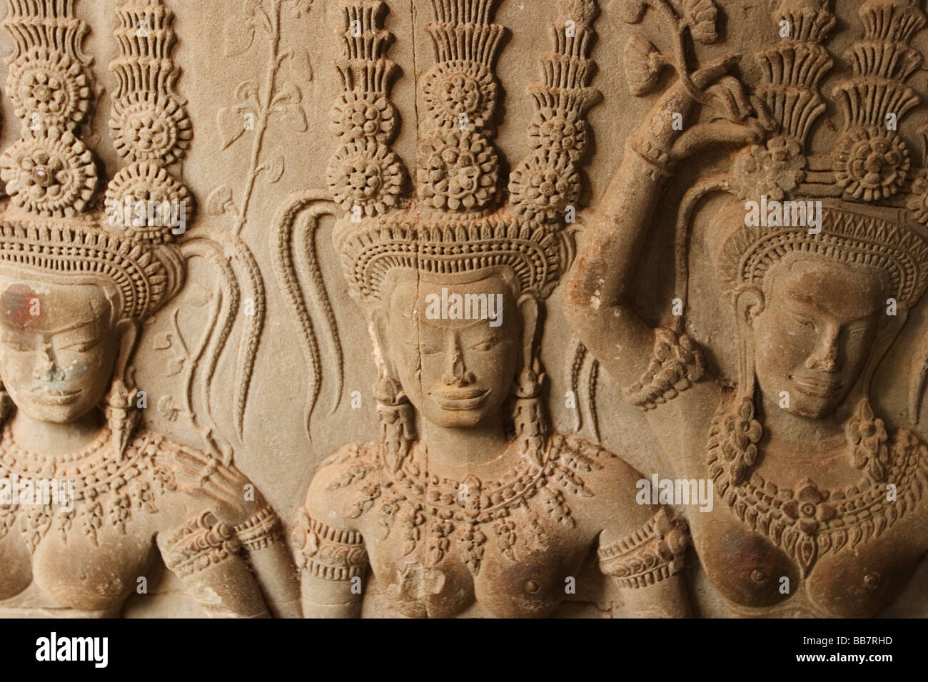 Devatas or asparas, celestial dancing girls, adorn the walls of Angkor Wat, Siem Reap Province, Kingdom of Cambodia. - Stock Image