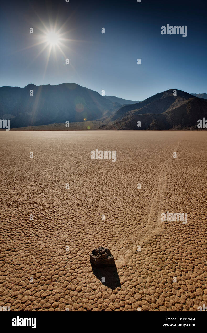 Moving rock on salt flats at The Racetrack in Death Valley National Park in California USA - Stock Image
