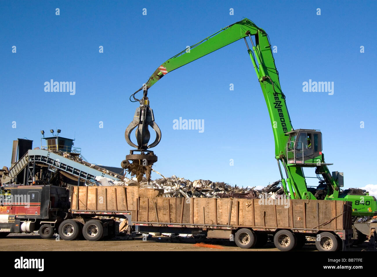 Electromagnetic crane lifting scrap steel for recycling at the Pacific Steel and Recycling center in Elmore County - Stock Image