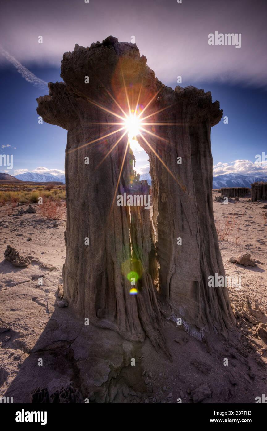 Natural starburst through tufa formations at Navy Beach near Mono Lake in California USA - Stock Image