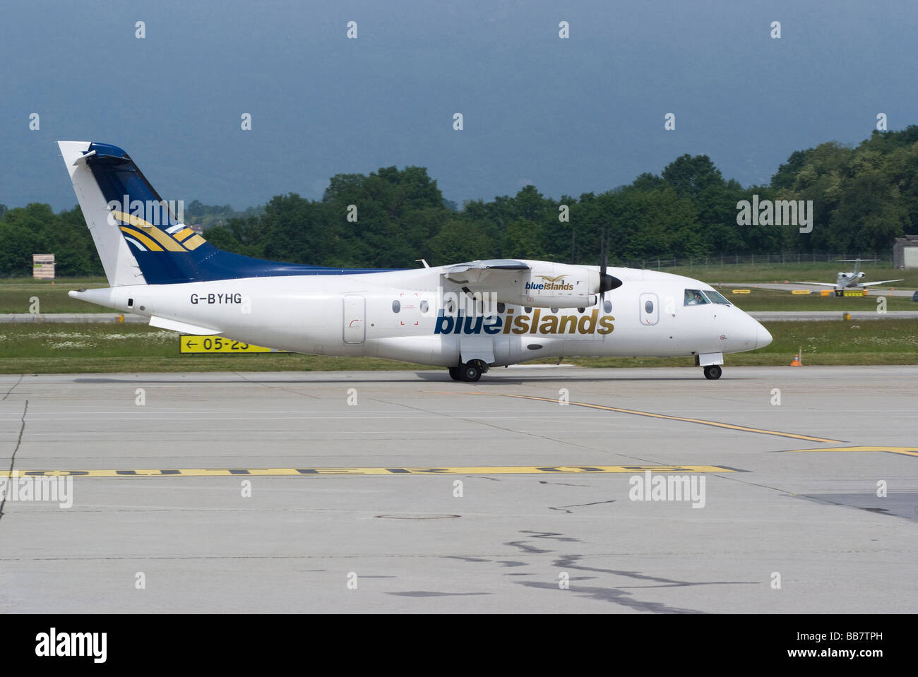 Blue Islands Dornier 328 (328-100 Mod.10) G-BYHG Turboprop Airliner Taxiing at Geneva Airport Switzerland Geneve - Stock Image