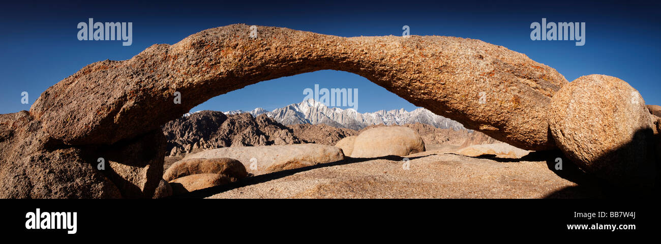 Panoramic view of Mount Whitney seen through natural rock arch near Lone Pine in California USA - Stock Image