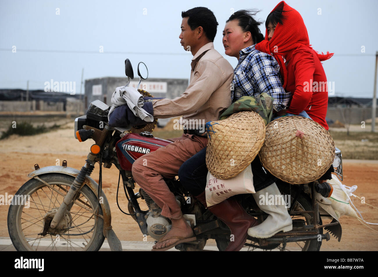 Three on a motorcycle in Zhangzhou, Fujian, China. 2009 - Stock Image