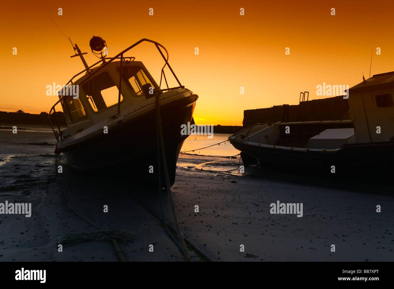 Boats on the shore in Rush, Co. Dublin, Ireland - Stock Image