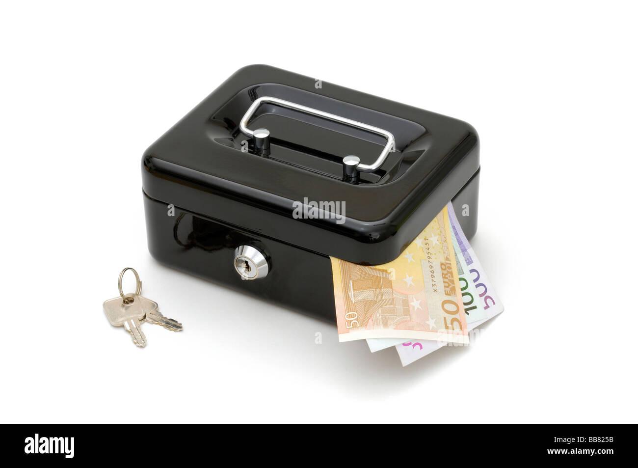 Black cash box, black money Stock Photo