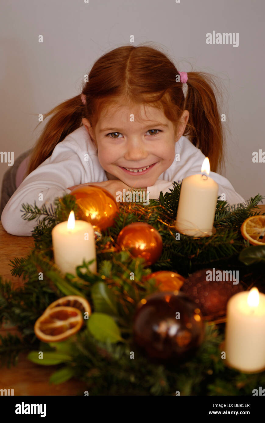 Girl with an advent wreath - Stock Image