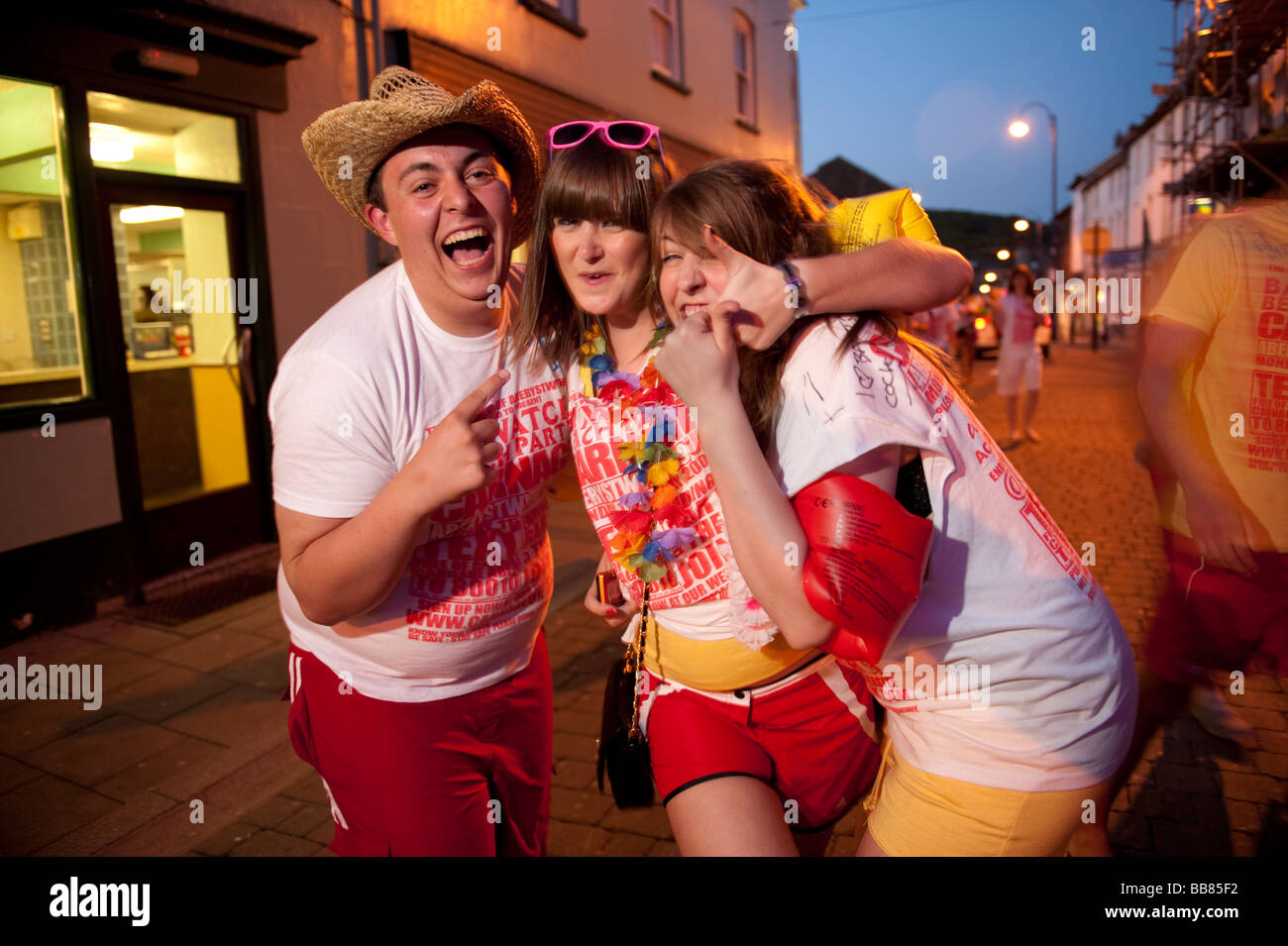 Three Aberystwyth University Students on a CARNAGE baywatch themed organised pub crawl around the town May 11 2009 - Stock Image