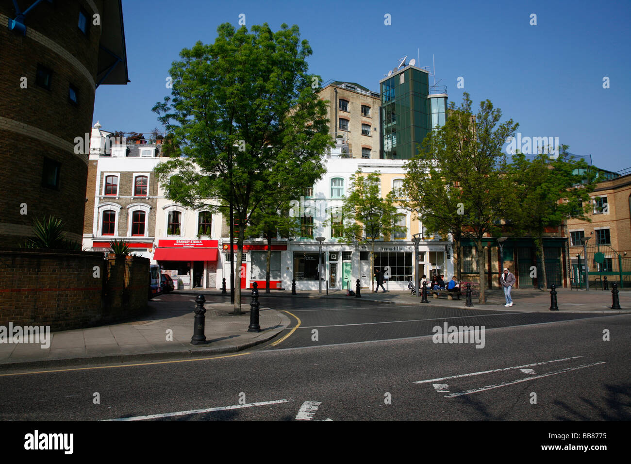 Parade of shops and cafes on Bramley Road in Notting Dale, London, UK - Stock Image