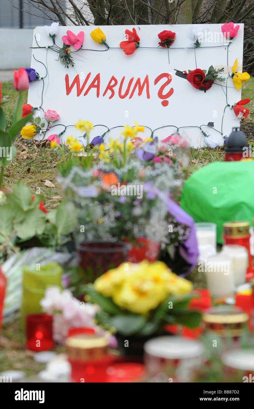 Rampage at Albertville Realschule school, the day after, flowers and candles to commemorate the victims, sign questioning - Stock Image