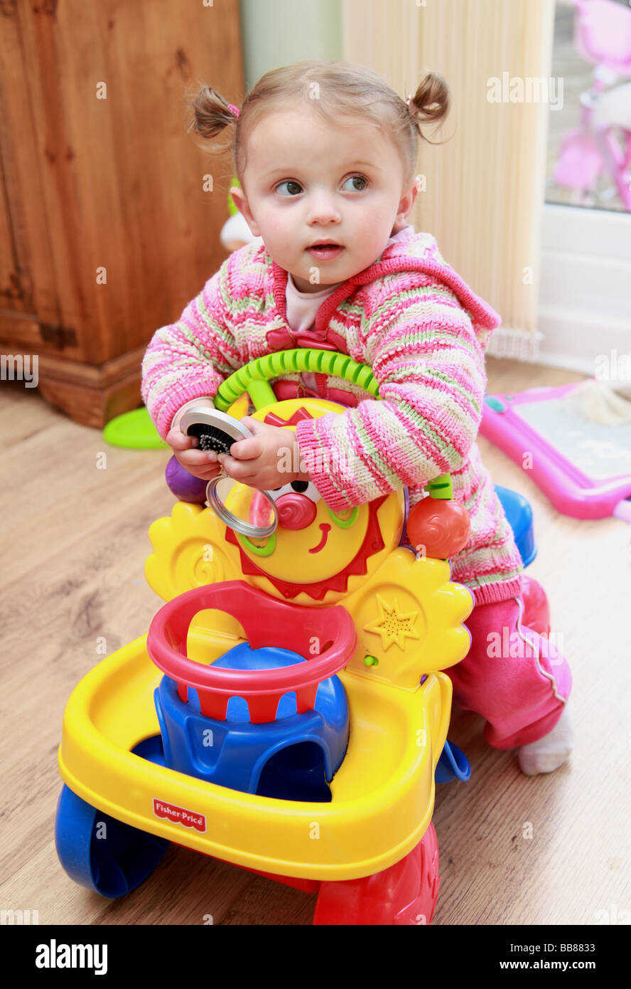 2 year old girl playing with toys Stock Photo