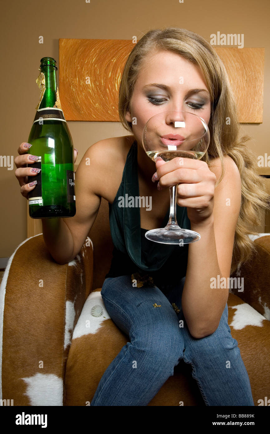 people, close-up, one, girl, woman, 15-20, 20-25, years, young, adult, long, haired, blonde, drink, bottle, glass, - Stock Image