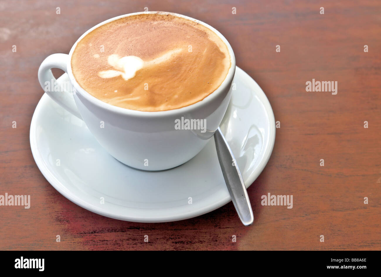 Coffee art in a cup with saucer - Stock Image