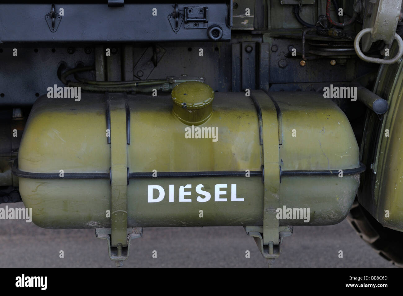 Large fuel tank of a truck in camouflage colours, labelled with Diesel - Stock Image