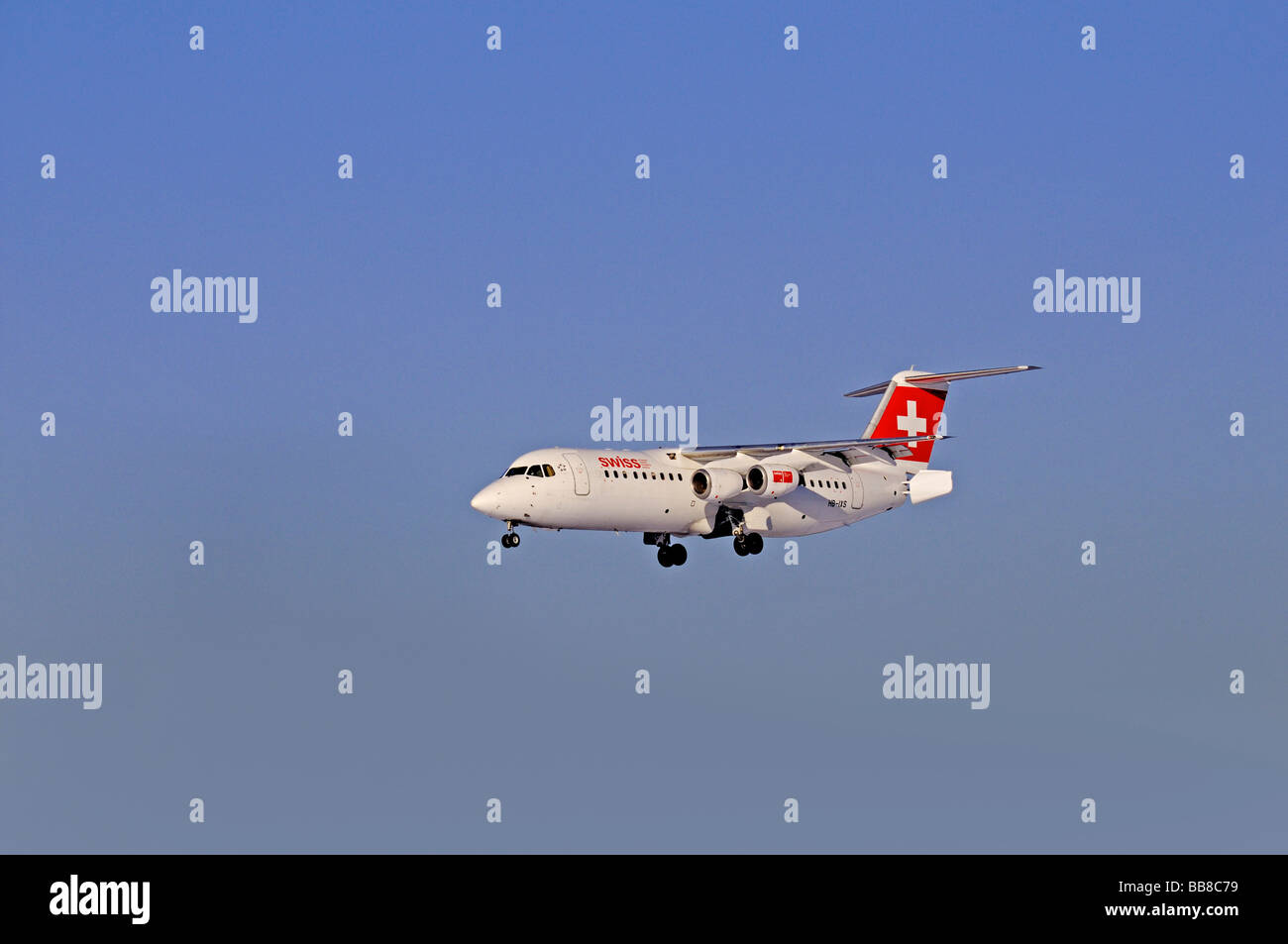 Commercial aircraft, Swissair, AI(R) Avro RJ & BAe 146, approaching to land against a hazy sky - Stock Image