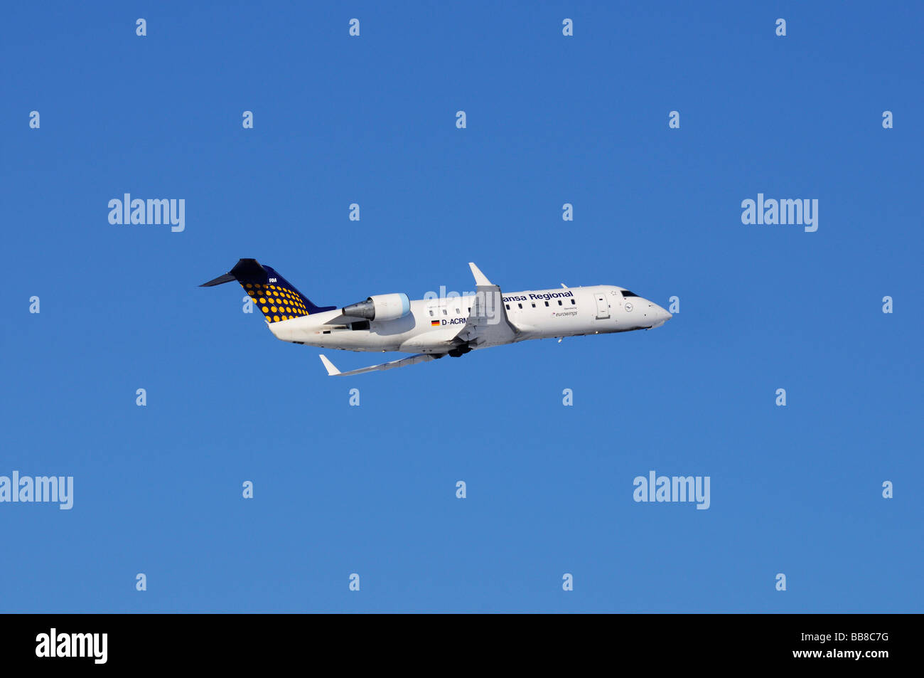 Commercial aircraft, Lufthansa Regional Eurowings, Canadair Regional Jet CRJ200, against a blue sky - Stock Image