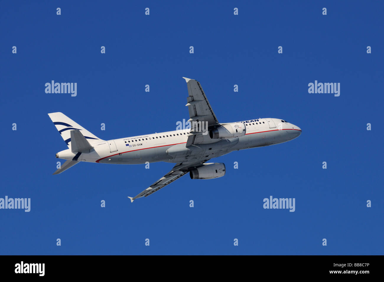 Commercial aircraft, Aegean Airlines, Airbus A320-200, climbing against a steel-blue sky - Stock Image