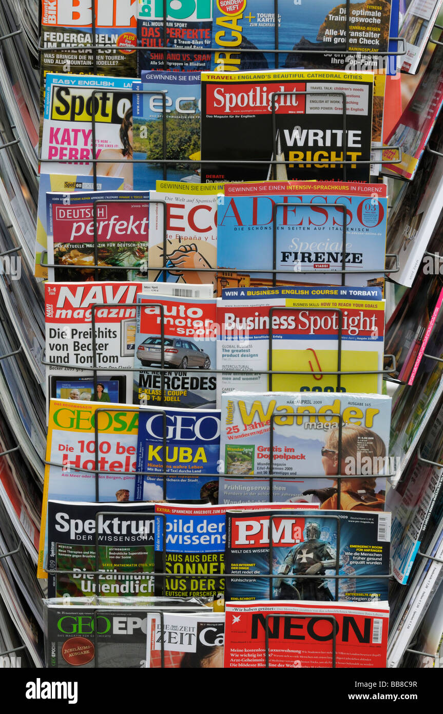 News rack with international magazines, newsagents - Stock Image