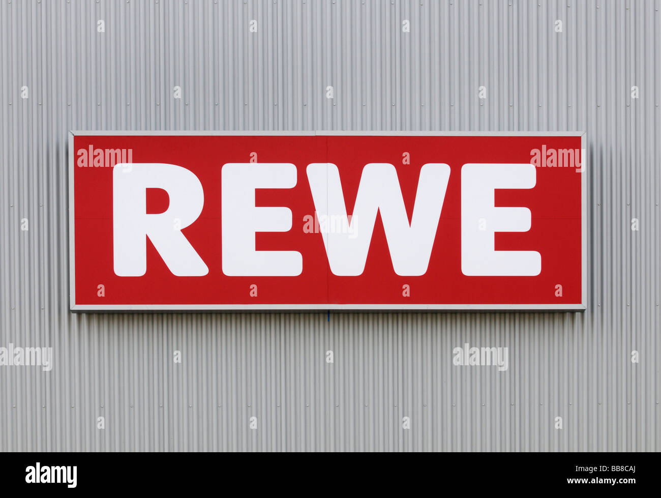 Rewe sing on frontage of corrugated iron - Stock Image