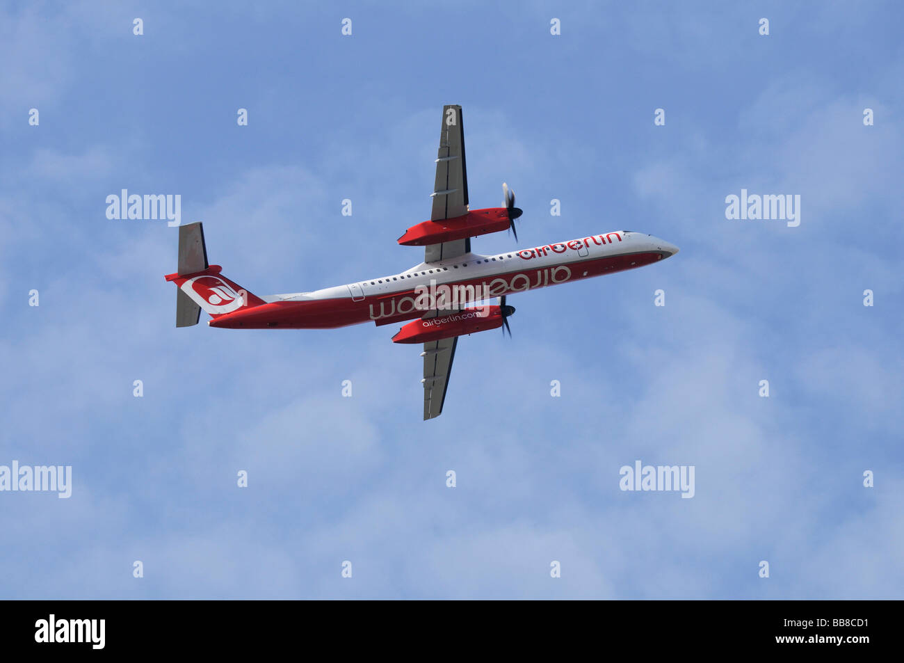 Airberlin Bombardier Q 400 twin-engined, medium range, turboprop airplane, ascending seen from below - Stock Image