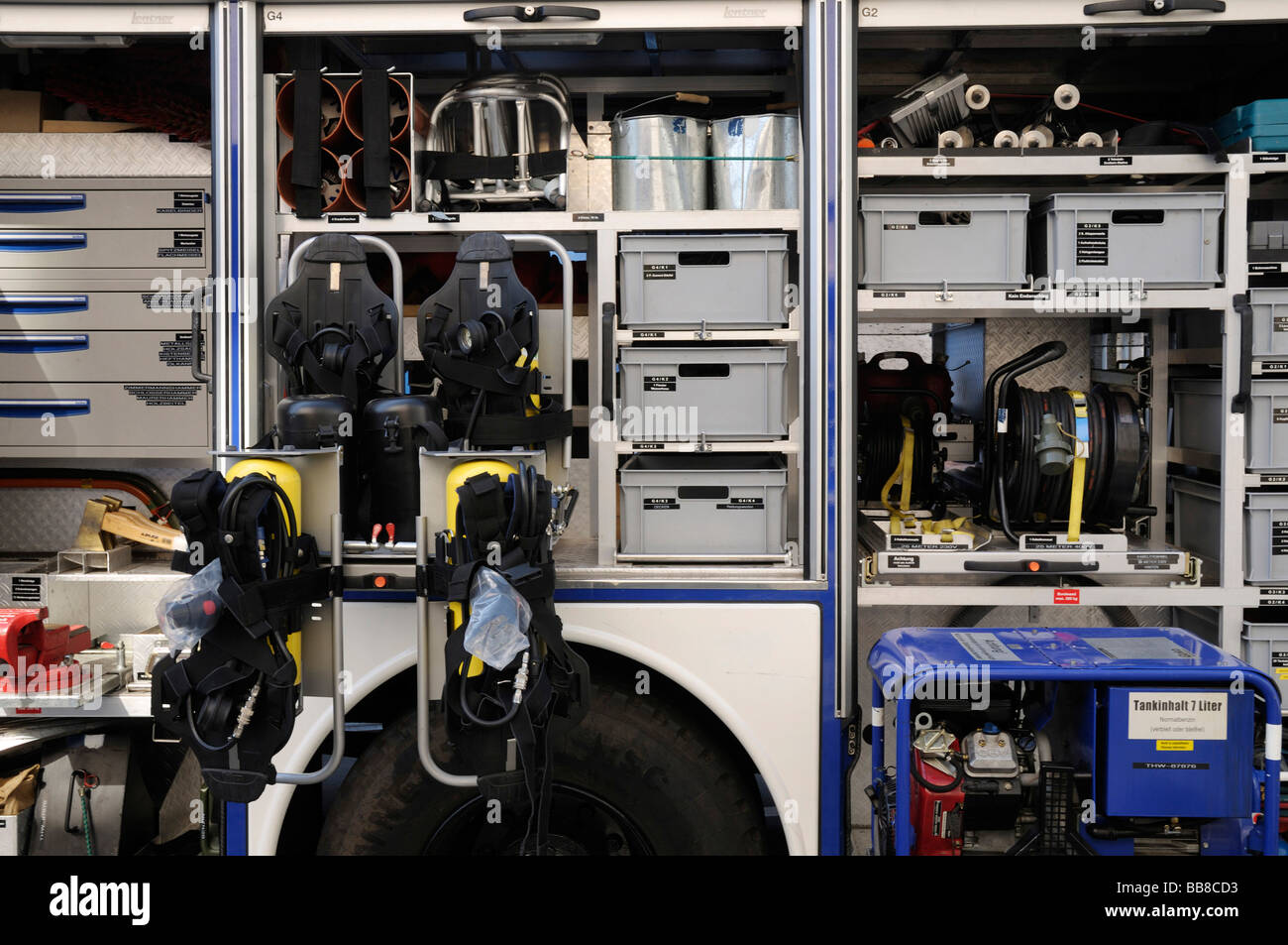 View into the compartments with safety clothes and tools of a Technisches Hilfswerk truck, THW, Federal Agency for - Stock Image