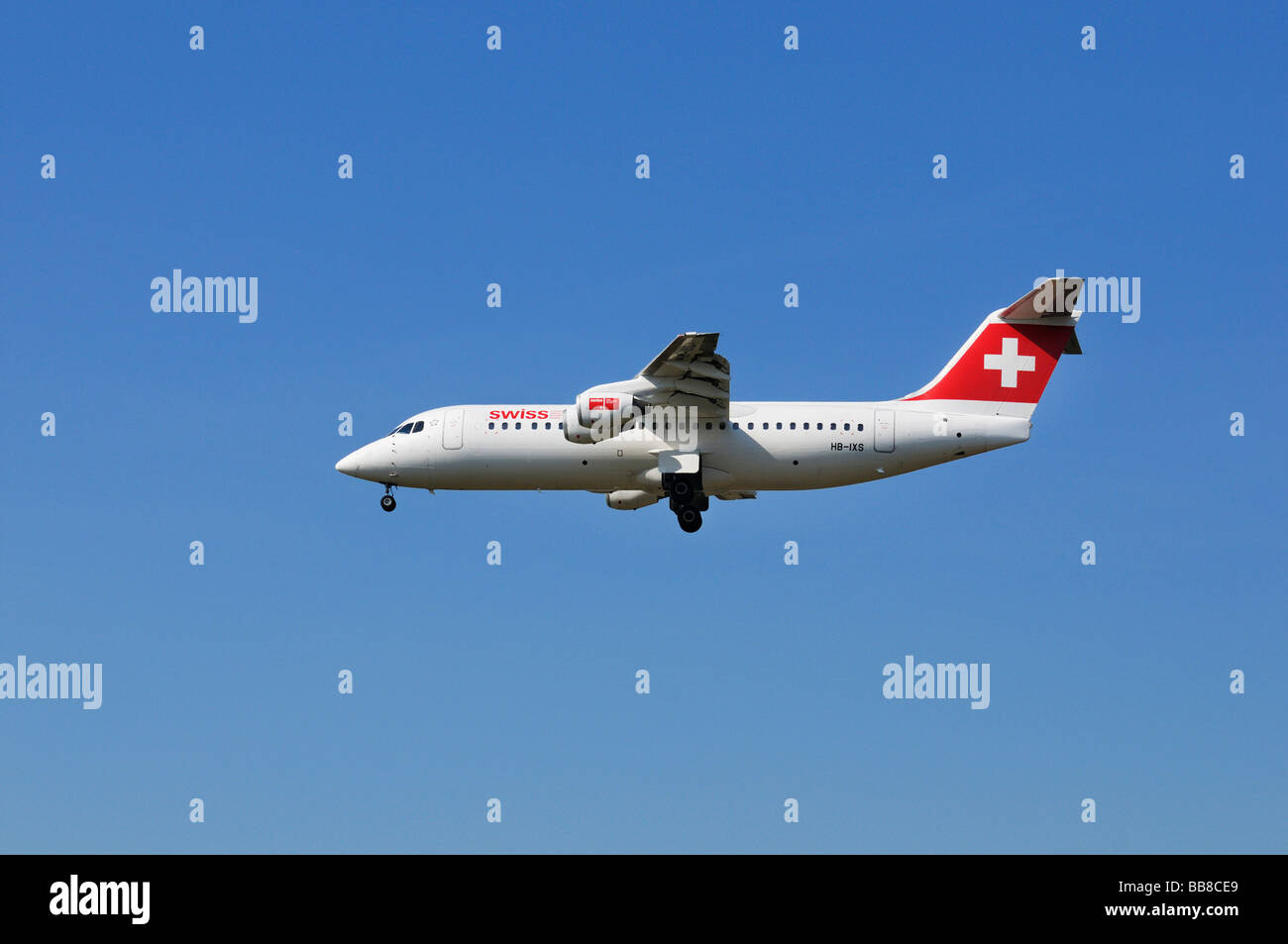 Swiss Air airplane Swiss Avro Regional Jet RJ100 is swinging out its landing gear - Stock Image