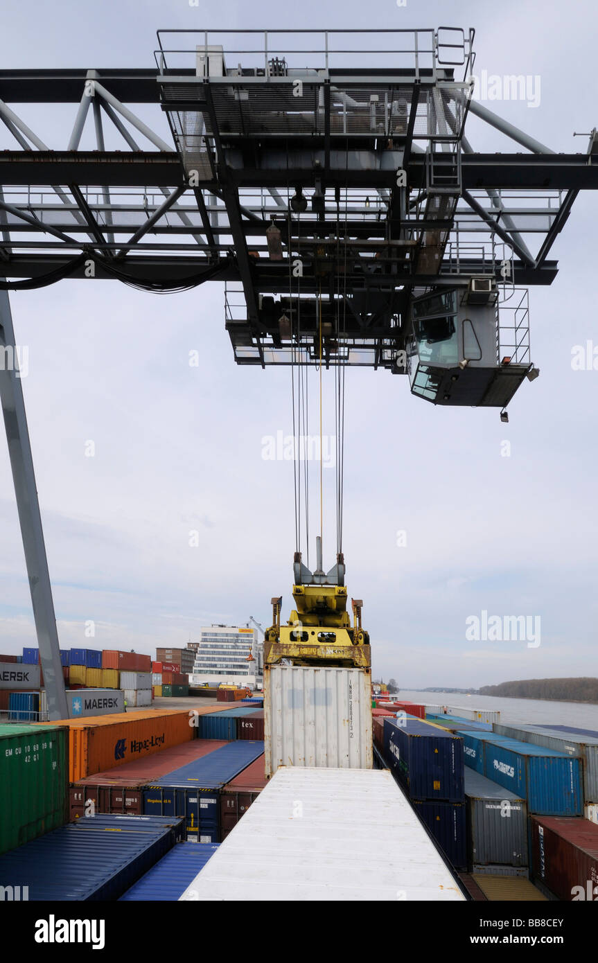 Harbour of Bonn, gantry crane letting containers down on a container ship, bimodal container handling, North Rhine-Westphalia,  Stock Photo