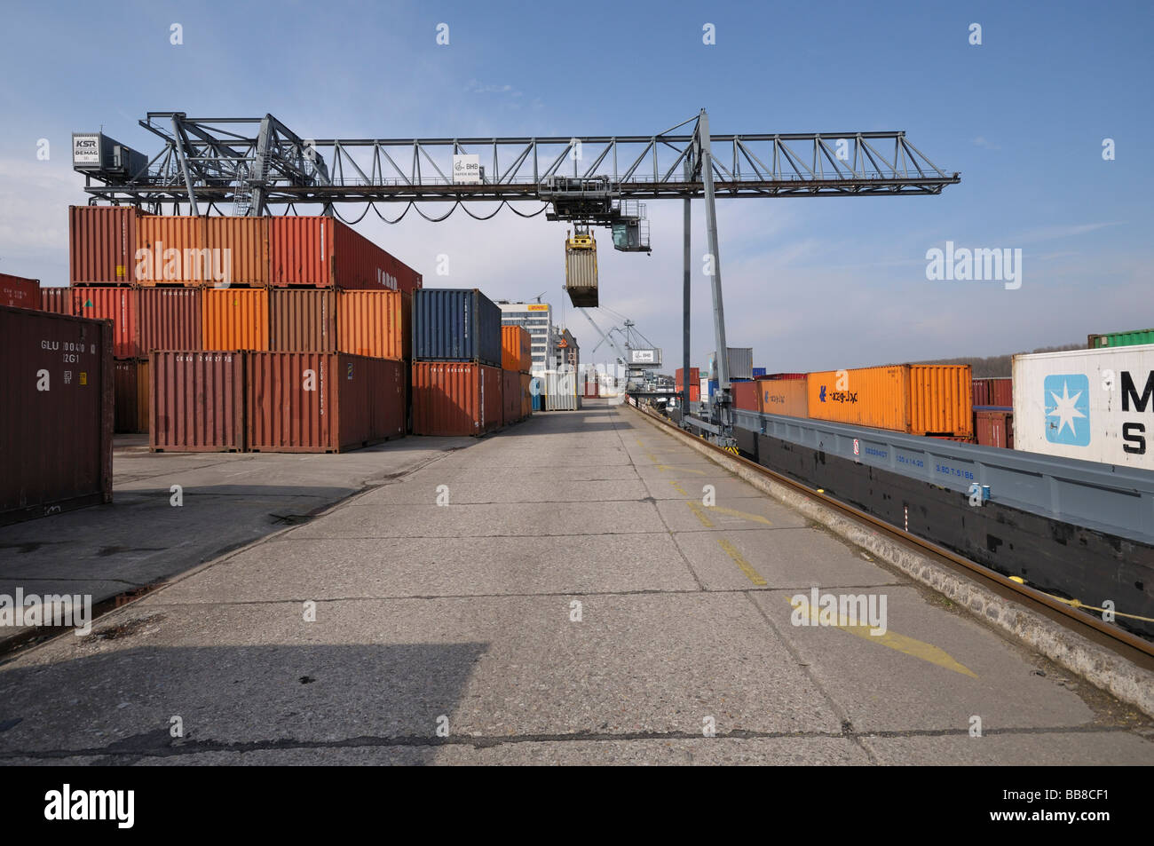 Harbour Bonn, ship at quay, beside it gantry crane transferring containers to and from a vessel, North Rhine-Westphalia, - Stock Image
