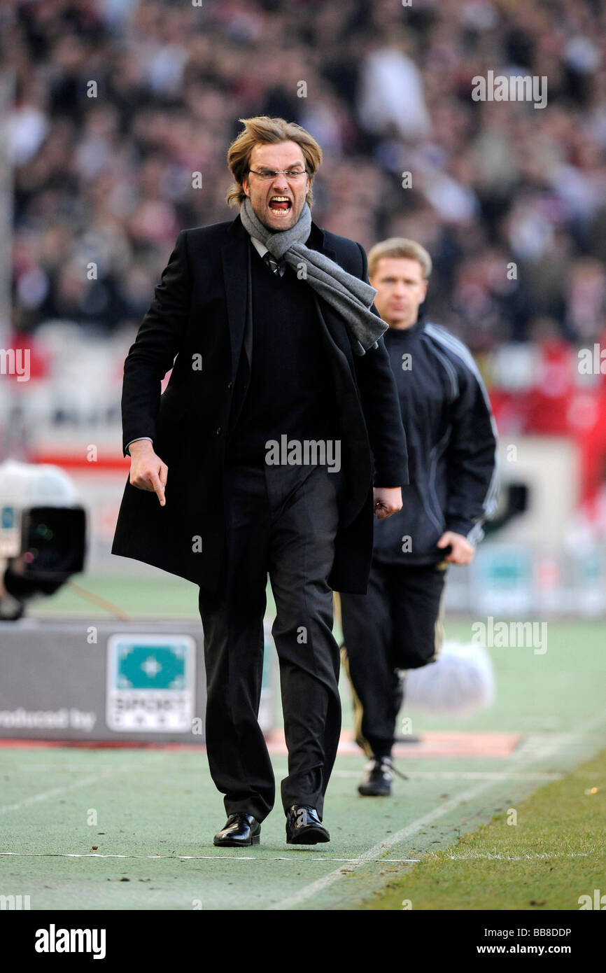 Coach Juergen Klopp, BVB Borussia Dortmund, angry at the sidelines, in the back the fourth official Tobias Welz - Stock Image