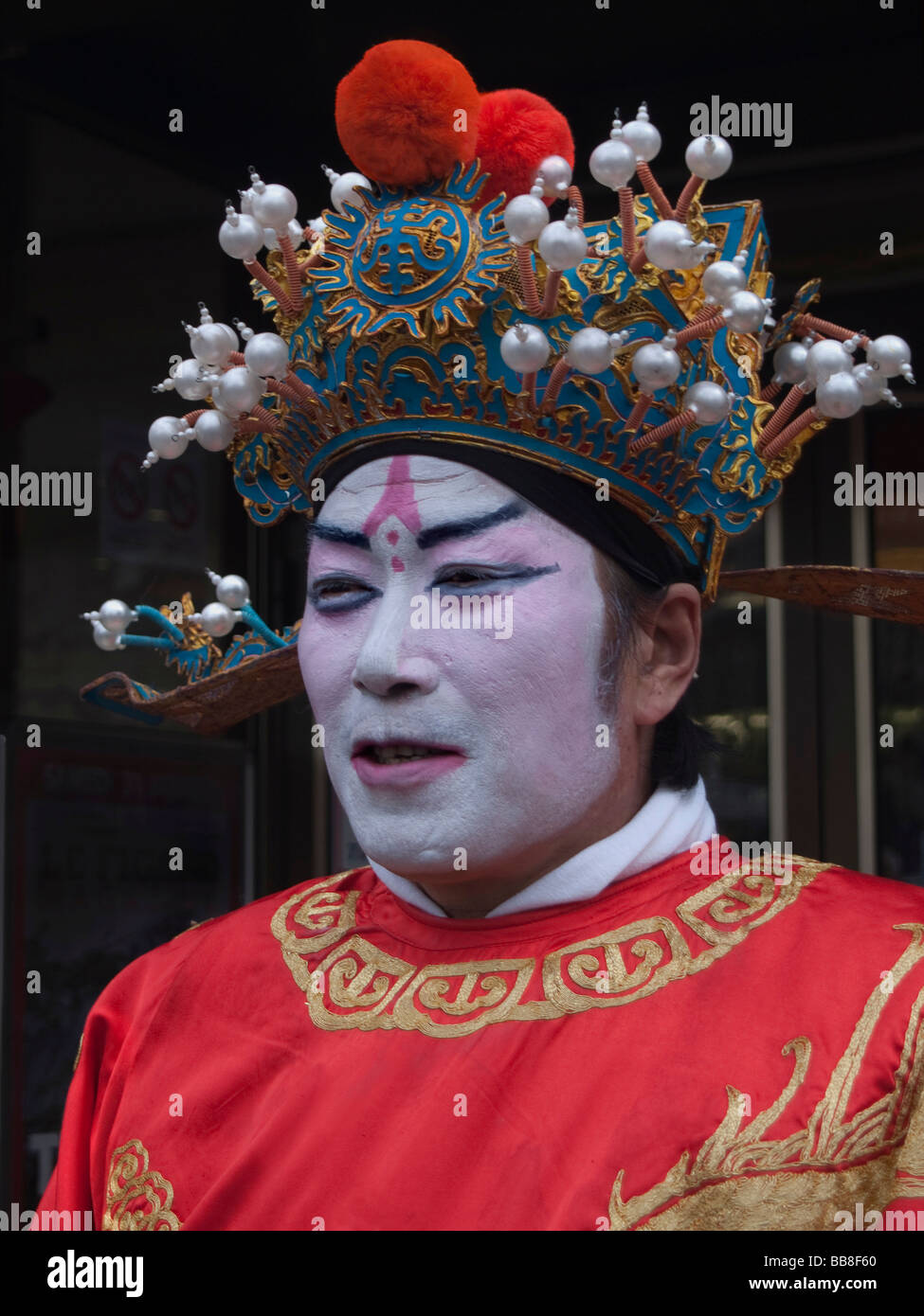 Chinese man wearing traditional garments and make-up, spring festival, Paris, France, Europe - Stock Image