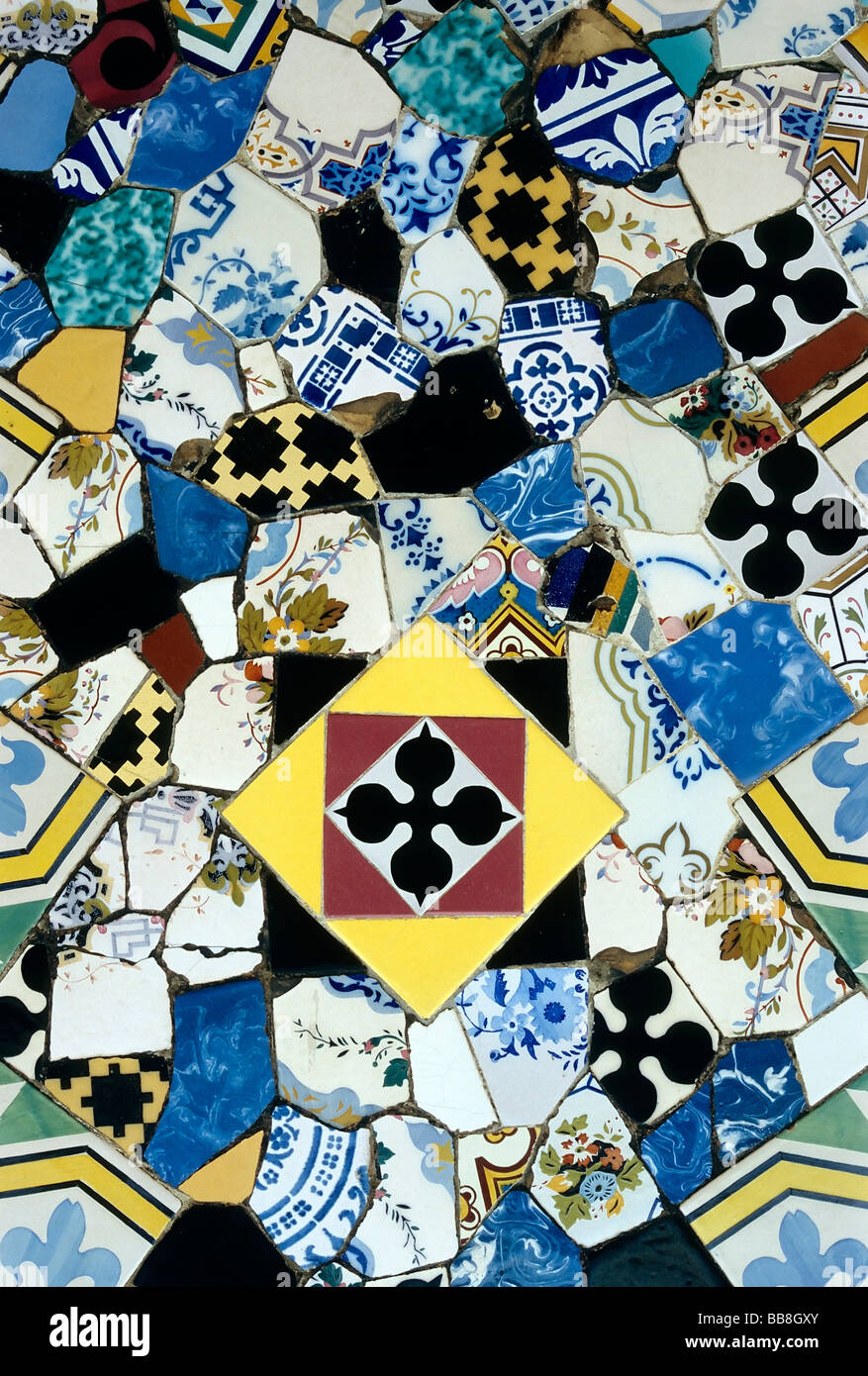 Mosaic of fragments of coloured ceramic tiles, Trencadi, detail of a chimney of the Palau Gueell, Barcelona, Spain, - Stock Image