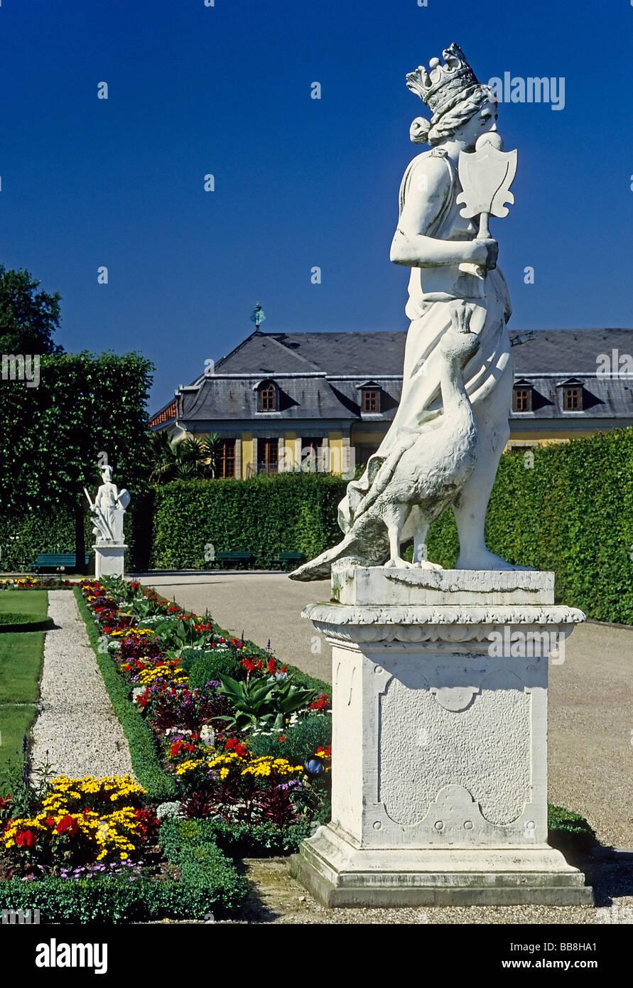Allegorical statue, woman with crown and peacock, Grosser Garten, Large Garden, Herrenhaeuser Gardens, Hanover, - Stock Image