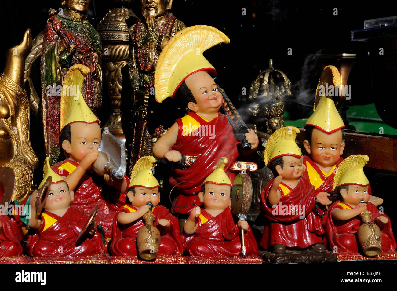 Kitschy Daja Lama figures in a shop window, Leh, Ladakh, North India, Himalayas, Asia - Stock Image