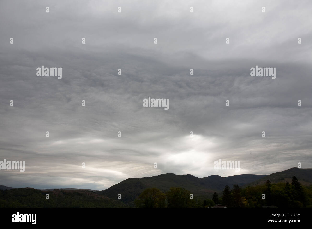 Patterns in clouds on an Occluded front over the Lake District Fells in Ambleside UK - Stock Image
