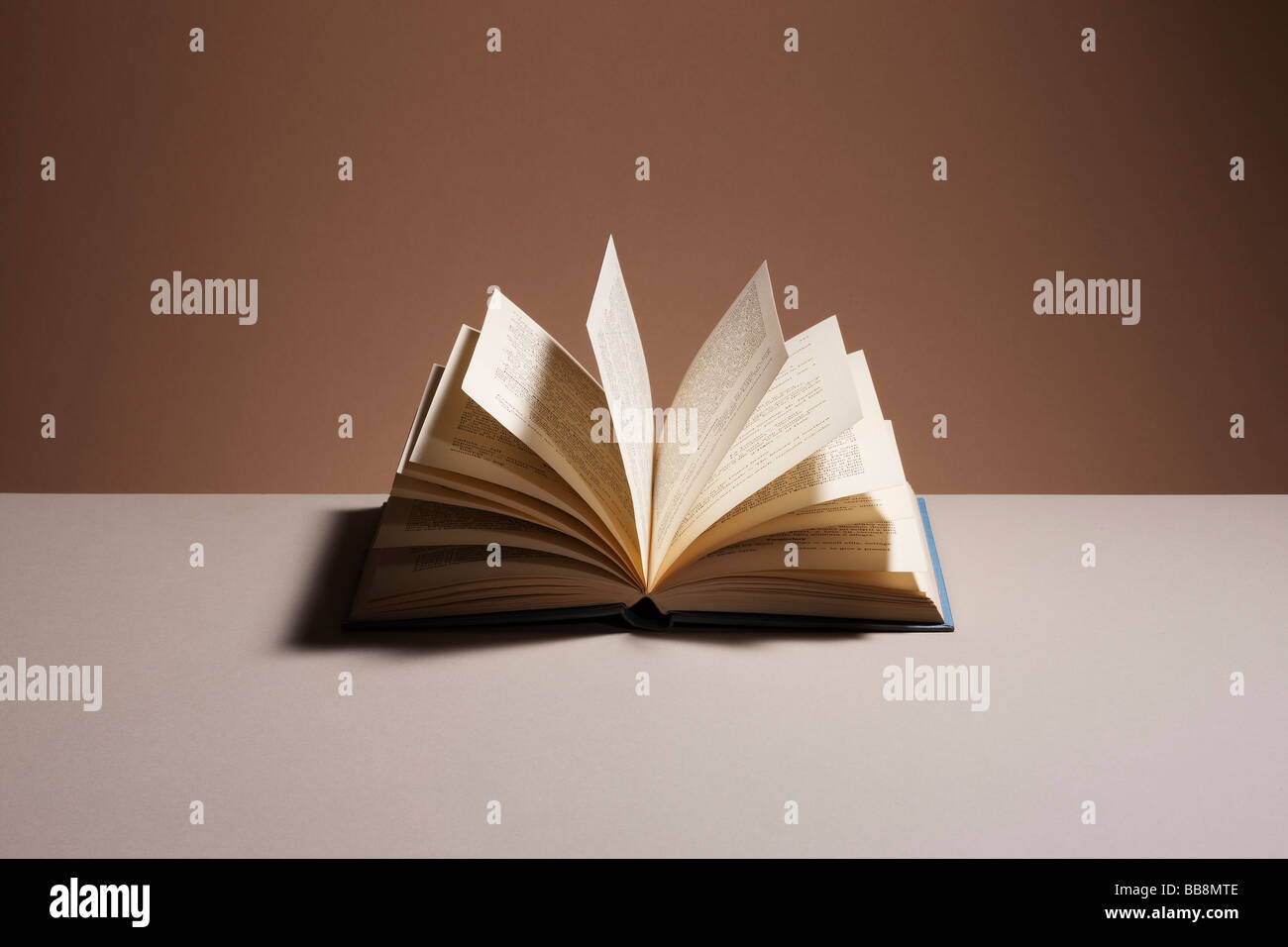 Open hardback book - Stock Image