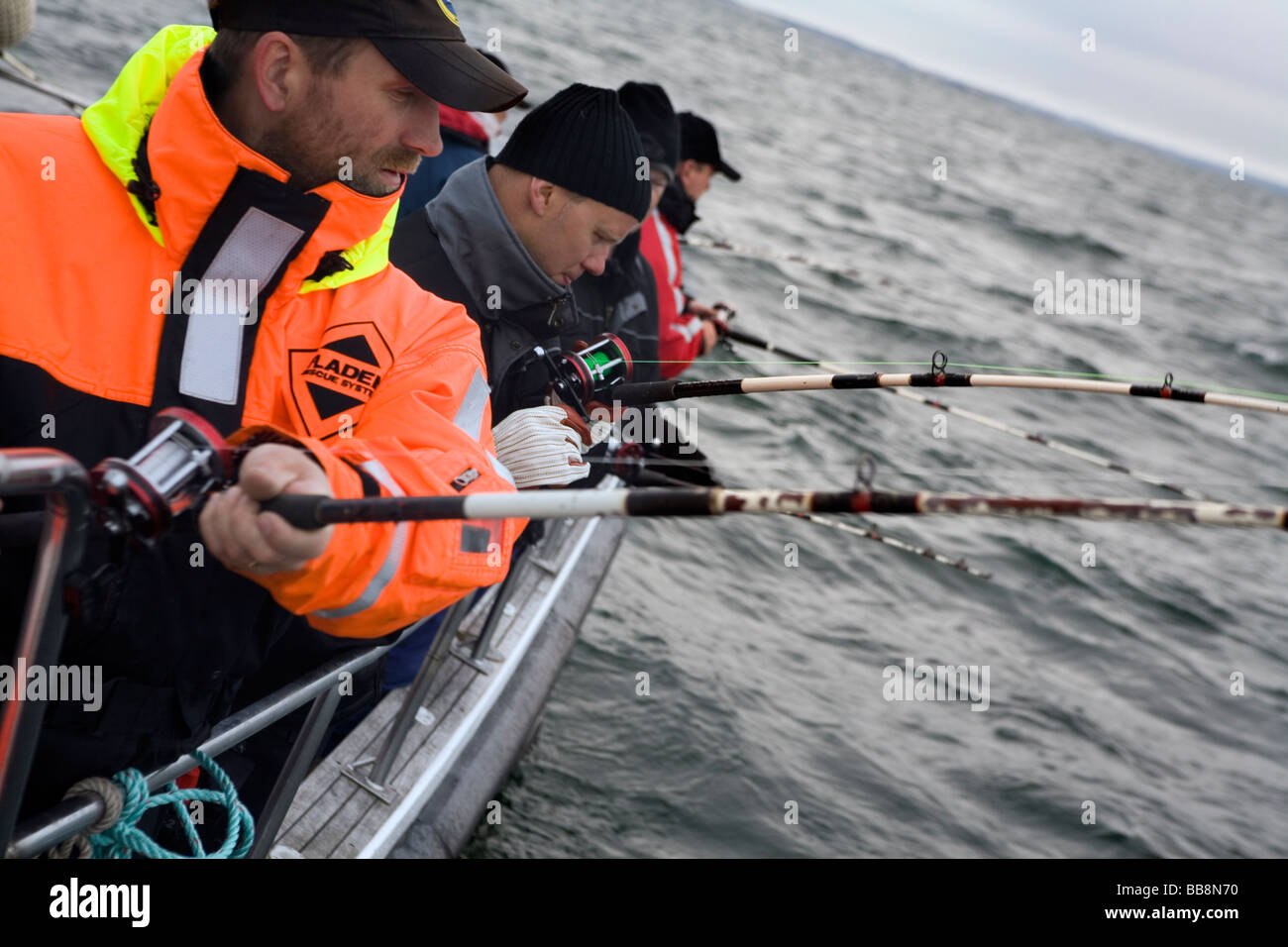 Men aboard at deep sea fishing trip Kattegat Sea Scandinavia - Stock Image