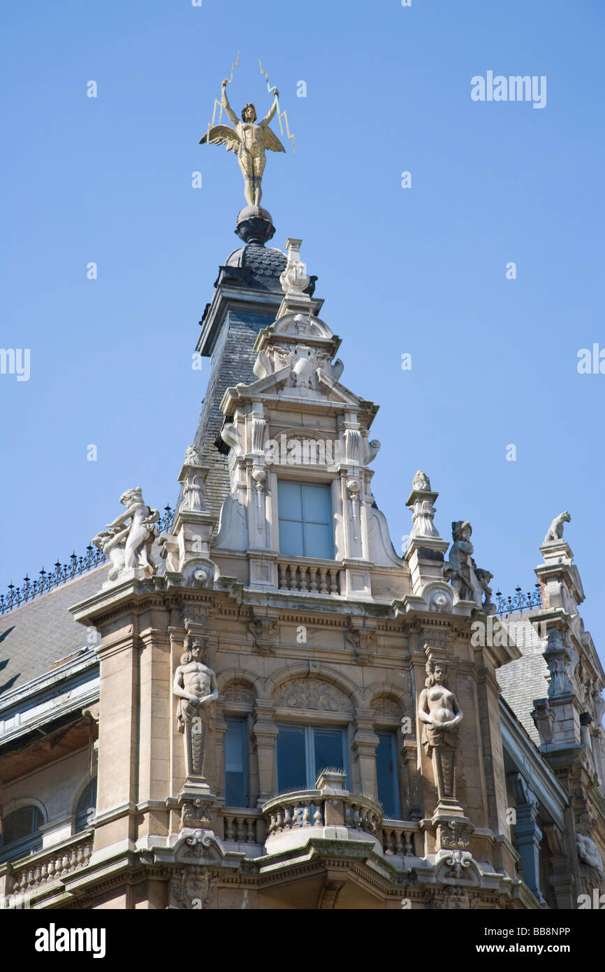 Angelic figure, poised high above the street, Meir, intersection of The Meir and Jesusstraat, Galeria Inno, Antwerp, - Stock Image