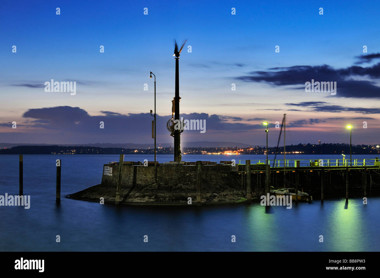 Harbour mole with the guidance statue in Meerburg on Lake Constance, Baden-Wuerttemberg, Germany, Europe - Stock Image