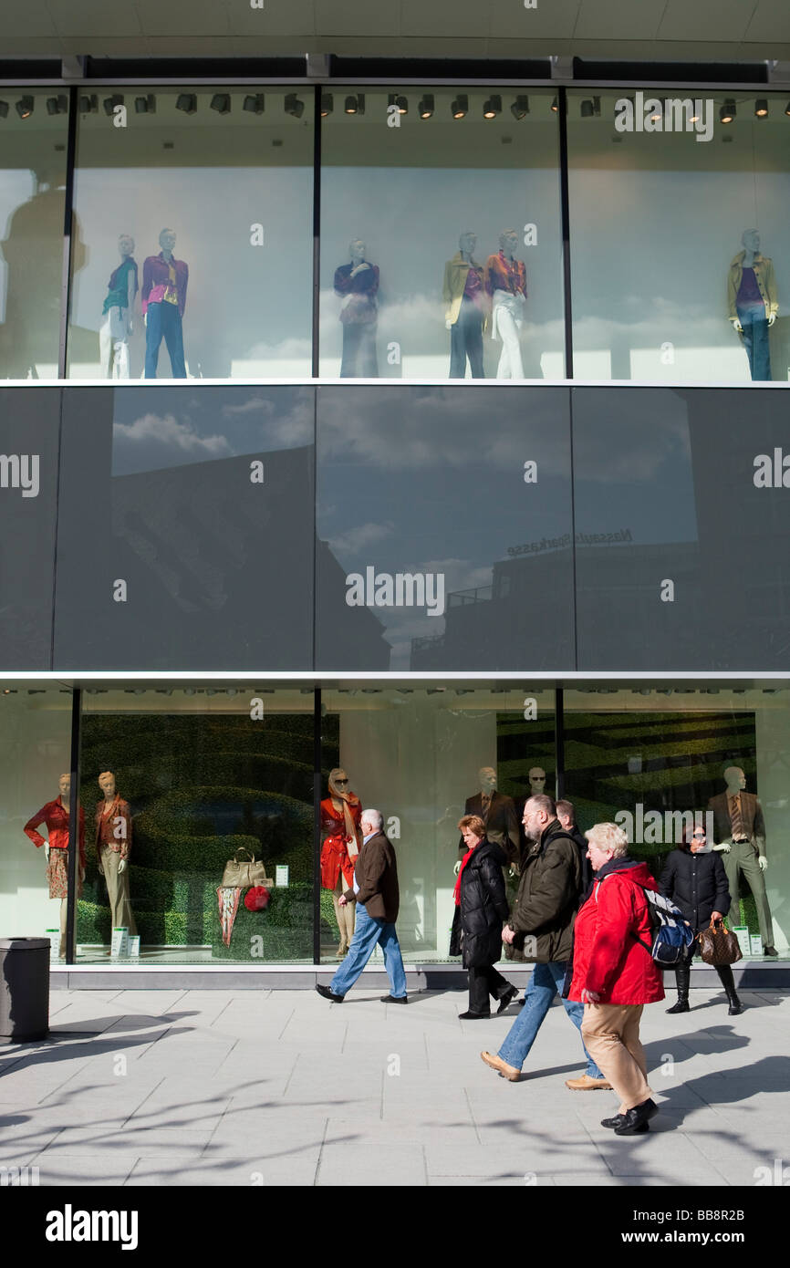 Shopping mall with shop window dummies and crowds in the city of Frankfurt, Hesse, Germany - Stock Image