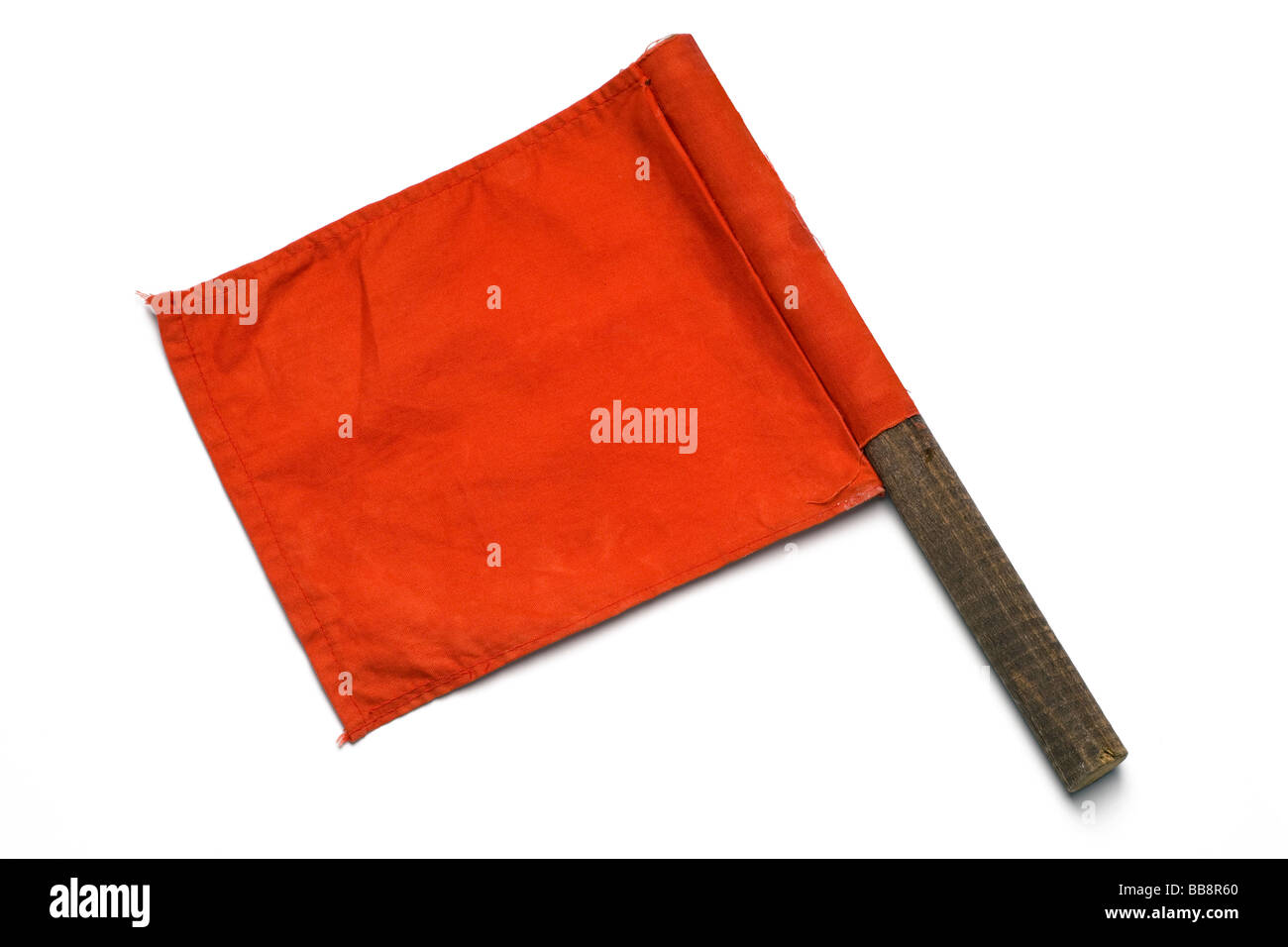 a red signaling flag on white - Stock Image