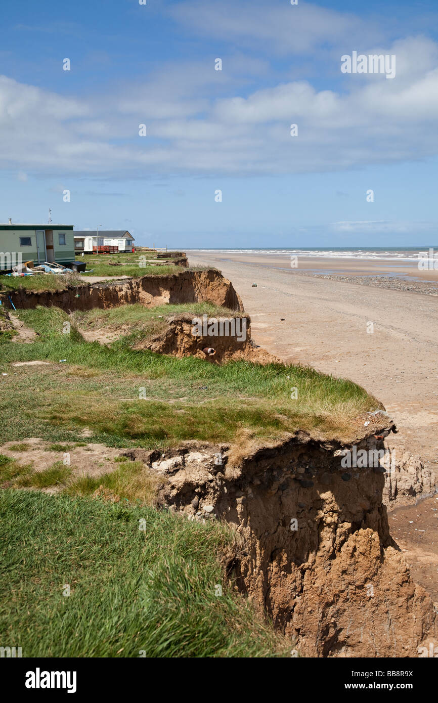 Holiday homes at a  caravan park in danger from North Sea coastal erosion on the cliffs of East Coast of England - Stock Image