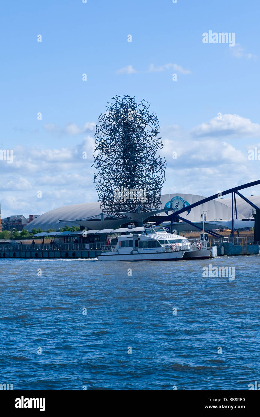 O2 Centre ,  Dome , The Millennium Man modern contemporary statue by Antony Gormley , part of Quantum Cloud Sculpture - Stock Image