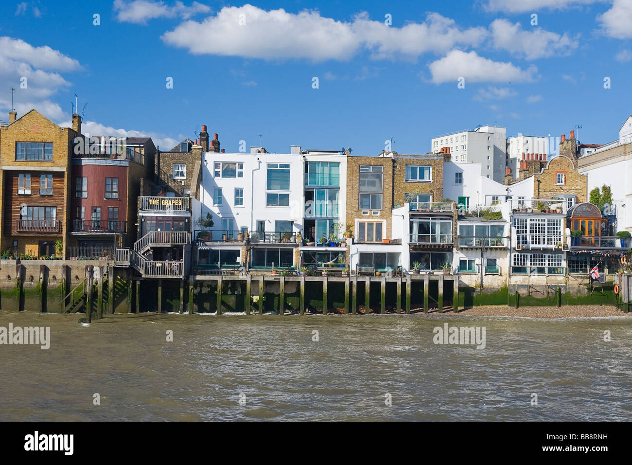East End riverside buildings including the famous Limehouse pub inn The Grapes dating back to 1583 frequented by - Stock Image