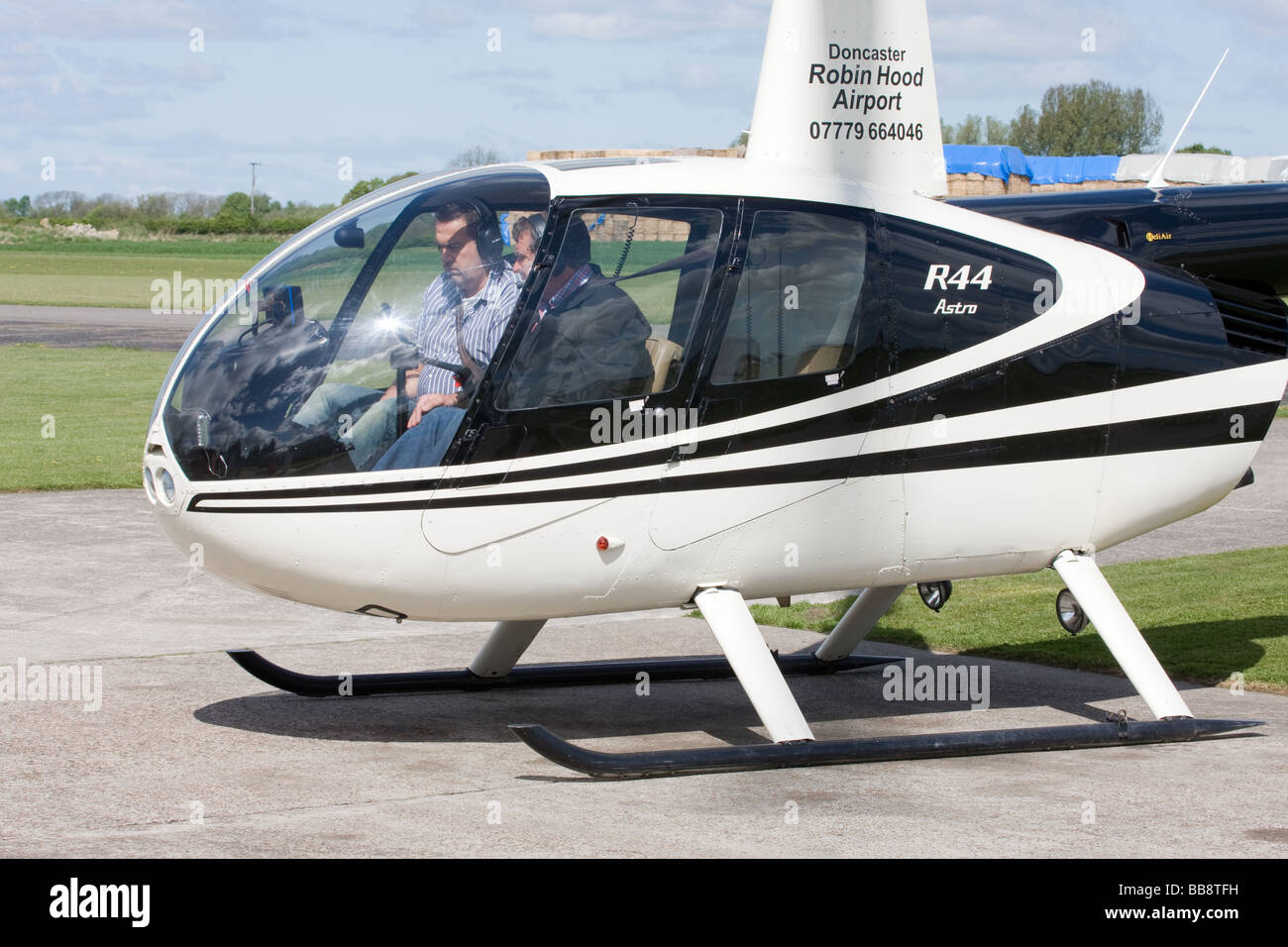 Robinson R44 Astro G-OWND on the ground at Breighton Airfield - Stock Image
