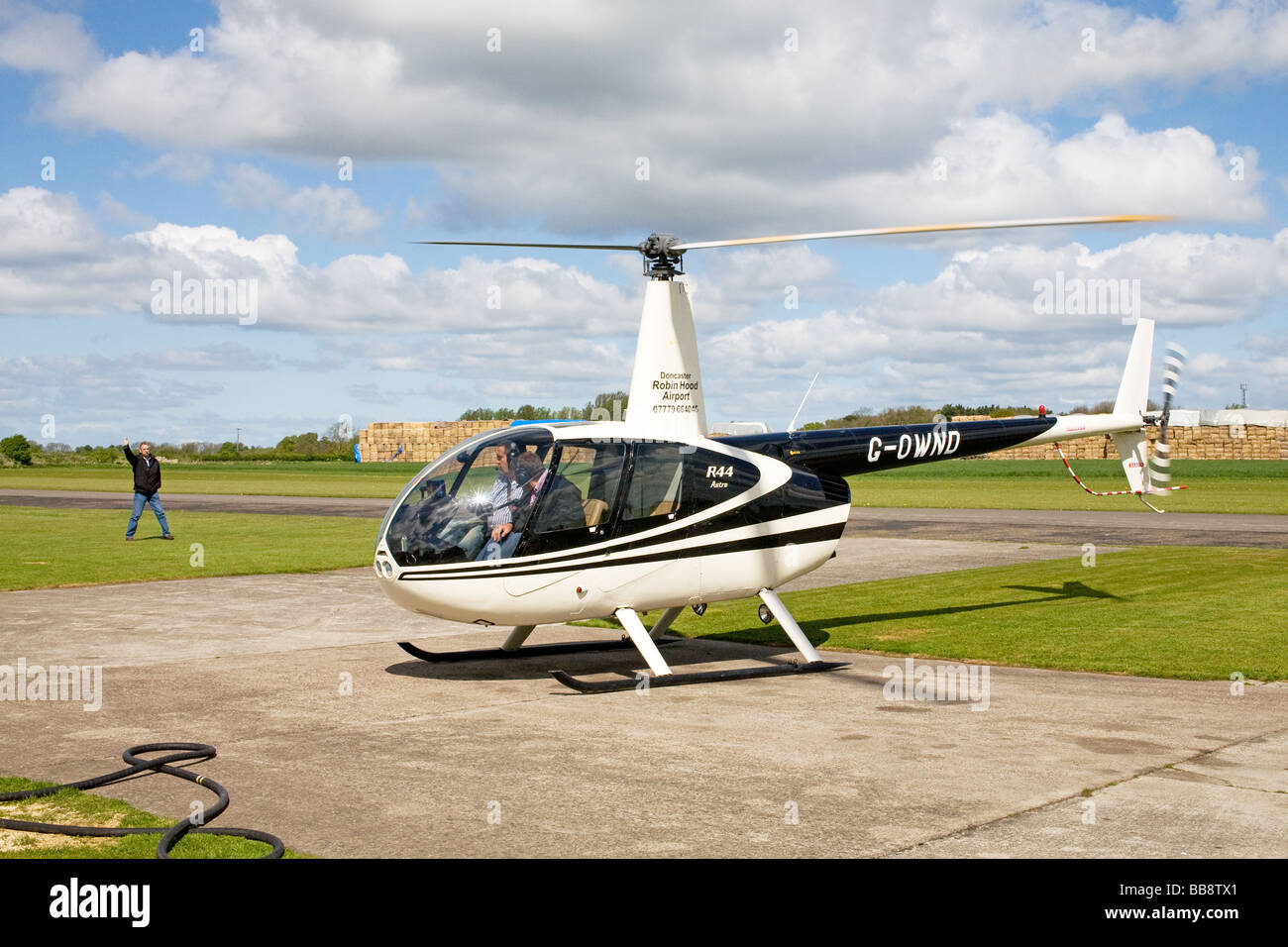 Robinson R44 Astro G-OWND about to depart at Breighton Airfield - Stock Image