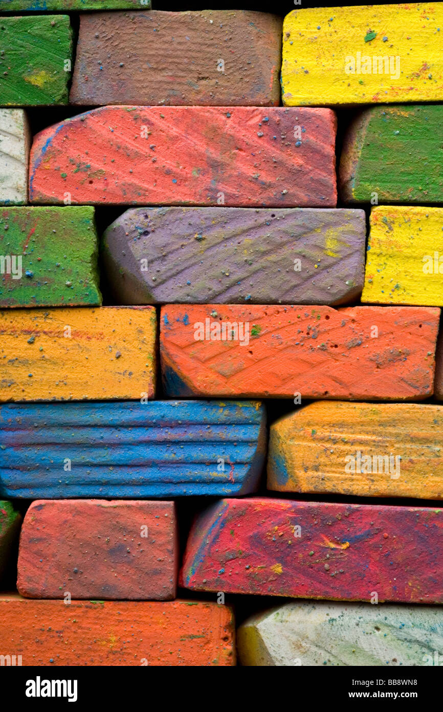 a brickwall of used colored chalks Stock Photo