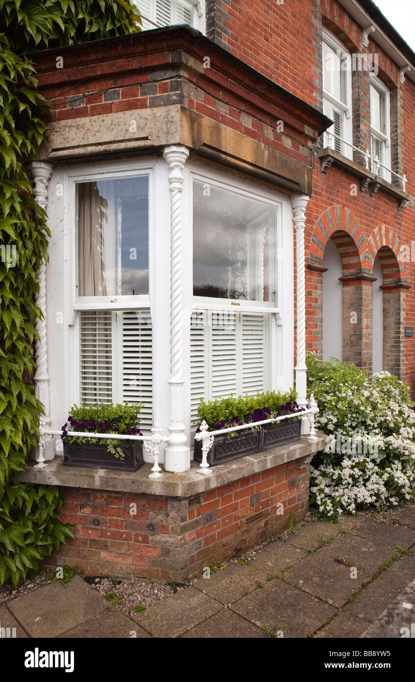 England Berkshire Cookham School Lane barley twist iron columns supporting house front bay window - Stock Image